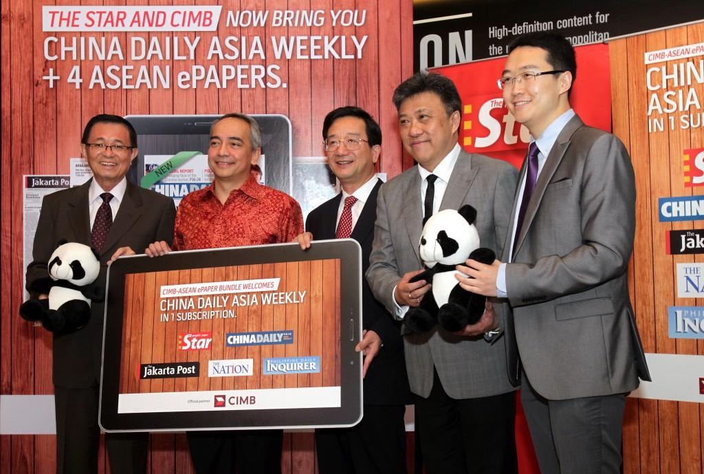 (From left) Datuk Fu Ah Kiow, Datuk Seri Nazir Razak, Huang Huikang, Datuk Seri Wong Chun Wai and Zhang Haizhou launching the CIMB-Asean ePaper collaboration with China Daily Asia Weekly at Menara Star, Petaling Jaya, on Friday.