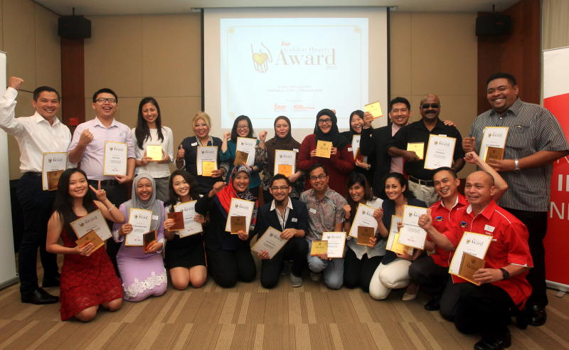 Star Golden Hearts Awards winners celebrating with their awards and certificates at Menara Star.