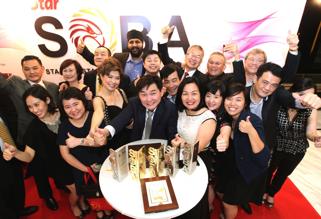 Malaysian Business of the Year (Above RM25mil category) winner Adrian Ng Meng Poh (centre) with the Mega Fortris (Malaysia) Sdn Bhd team after the company was announced as one of the grand winners at The SOBA 2016.