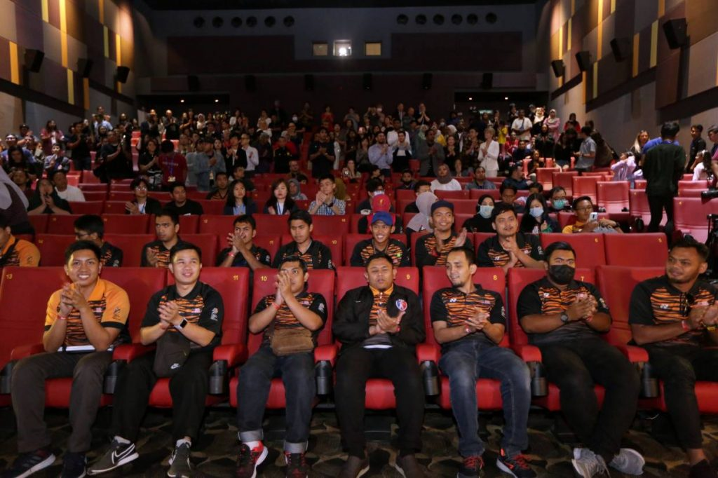 National Blind Footballers include those featured in the Eye On The Ball film receive a standing ovation by the star-studded audience.